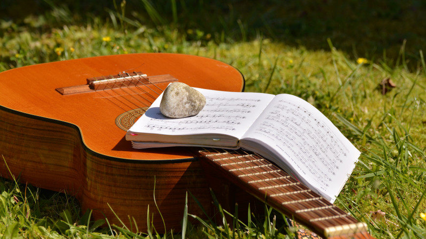 New music in the sunshine on a guitar
