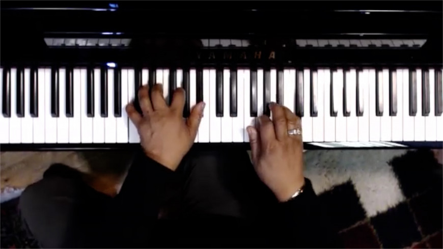 An over the keys shot using an external webcam for multicam set up for online piano lessons