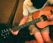 Left handed boy with guitar